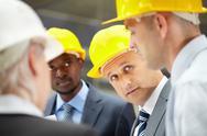 Four architects negotiating their work Stock Photos