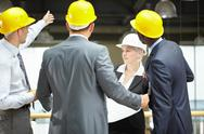 Construction executive showing the site to inspector Stock Photos