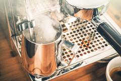 Steaming Milk For Cappuccino Coffee. Steaming Milk in Metal Steaming Pitcher Stock Photos