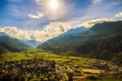 Idyllic summer landscape in the Alps with fresh green mountain Stock Photos