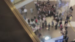 Man puts brown bags with sale sticker on it on floor in mall on black friday Stock Footage