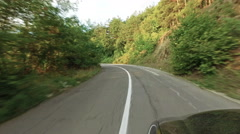 Timelapse of pov drive on rural mountain road with appearance of sunset sun Stock Footage