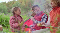 Children Frying Meat on Campfire Stock Footage