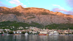 Makarska harbour and old town filmed in evening light. Stock Footage