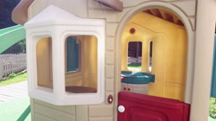 Empty small children's playhouse outside, kid's plastic toy in the backyard Stock Footage