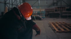 Welder Industrial automotive part in factory with sparks Stock Footage
