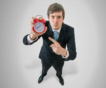 Deadline concept. Angry boss is showing clock. Stock Photos