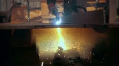 Welder in factory welding metal in modern stock workshop Stock Footage