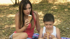 Mother and son give to taste each other their ice cream Stock Footage