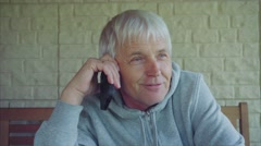Senior caucasian man with gray hair talking on cell phone Stock Footage
