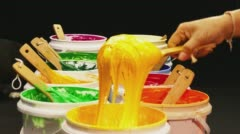 Scoop yellow ink out of can Stock Footage