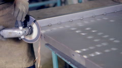 Worker using industrial grinder operating with metal at a metal processing plant Stock Footage