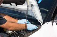 Mechanic man at work on a car repairing Stock Photos