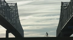 Bridge with Fast Biker Right To Left, Silhouetted Stock Footage
