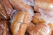 Bags of fresh sliced bread for a food drive Stock Photos