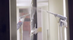 Painter in a factory. Industrial painting with spray gun Stock Footage