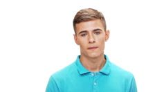 Upset young man looking at camera over white background Slow motion Stock Footage