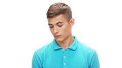 Displeased young man speaking on phone over white background Slow motion Stock Footage
