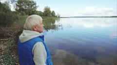 Video of senior man gray hair looking at the lake Stock Footage