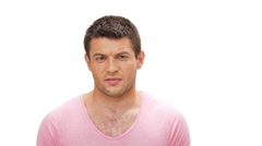 Diapleased young man looking at camera over white background Slow motion Stock Footage
