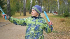 Boy makes big soap bubbles in the Park with delight Stock Footage