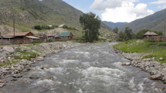 Mountain village with  rapids of  river Stock Footage
