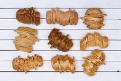 Nine sliced loaves of various breads Stock Photos