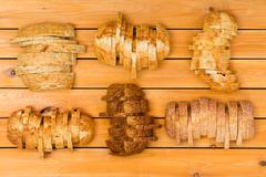 Six sliced loaves of various breads Stock Photos