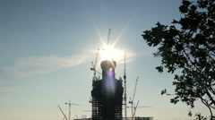 Silhouette of Tall Tower, Bright Sun Making Backlight Behind Stock Footage