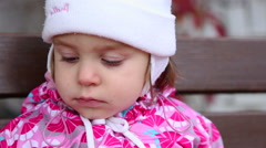 Pretty child with air balloon seating on the bench. Stock Footage