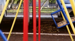 The colourful swing on kid's playground. Stock Footage