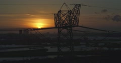 Sunset electric pole aerial shot with drone with Cityscape of Amsterdam Stock Footage