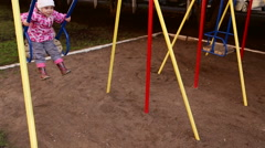 Child on a swing. Stock Footage