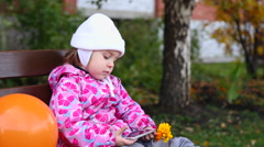 Girl with smartphone and flower. Autumn day. Stock Footage