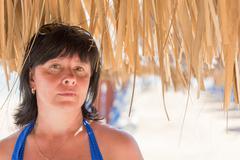 Woman palm beach umbrella Stock Photos