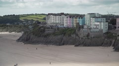 A view of the buildings overlooking the beach, taken from St Catherines Island. Stock Footage