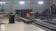 Moving of the metal workpiece by electric overhead crane Stock Footage