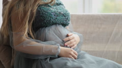Shot of a pregnant woman holding and touching her stomach Stock Footage
