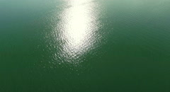 Beautiful Lake Constance flying aerial Shot with sun reflection. Stock Footage