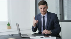 Young businessman writing down a good idea on a piece of paper Stock Footage