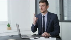 Young businessman hitting upon an idea Stock Footage
