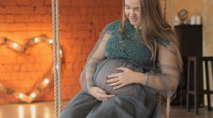 Pregnant woman sitting on swings decorated. Family concept. Maternity concept Stock Footage