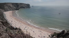 Arrifana beach in Portugal, longshot, summer afternoon. Stock Footage