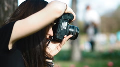 Photographer work with model outdoor Stock Footage