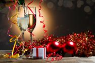 Champagne fills the glasses and festive Christmas decorations Stock Photos
