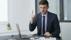 Young businessman coming up with a good idea. Stock Footage