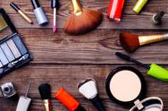 Makeup cosmetics, brushes and other on brown background Stock Photos