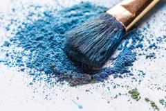 Shadows of blue-green color with brush on white background Stock Photos