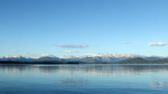 Wide-angle view of ice-covered mountains next to a lake near Bariloche, Argentin Stock Footage