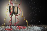 Two champagne glasses on black background with backlight and snowfall Stock Photos